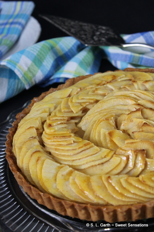 Tarte aux Pommes is a classic French apple tart. Thinly sliced apples are laid in circles and brushed with warm apricot jam.