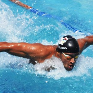 man swimming strongly