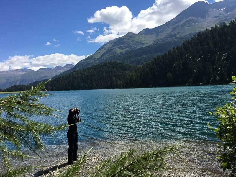 girl photographing lake silvaplana