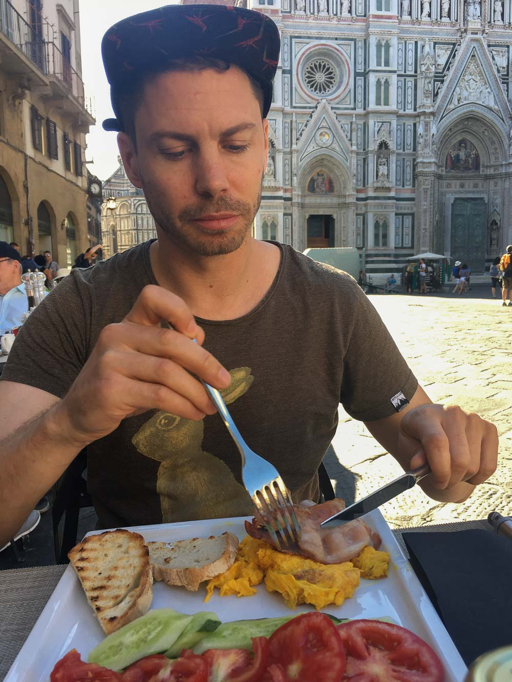 Jerry Enjoying Breakfast with a view of the Santa Maria del Fiore in Florence, Italy