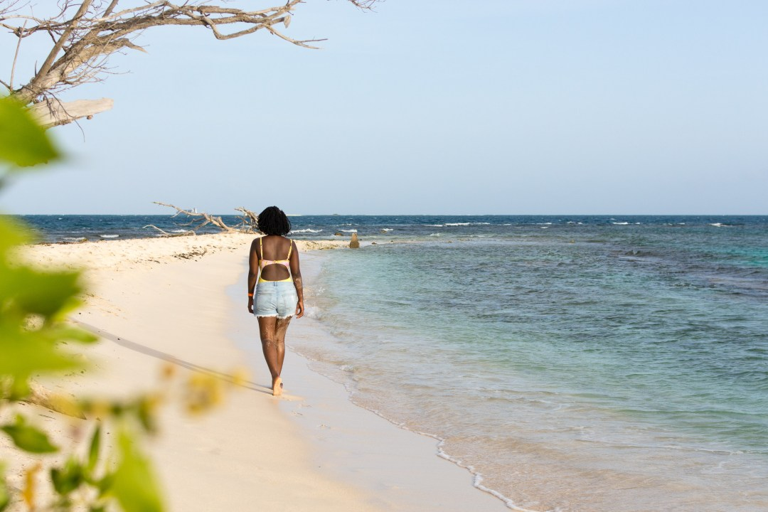 Girl walking on Lime Cay Beach