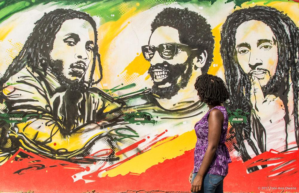 Toni-Ann Looking at Artwork at the Bob Marley Museum