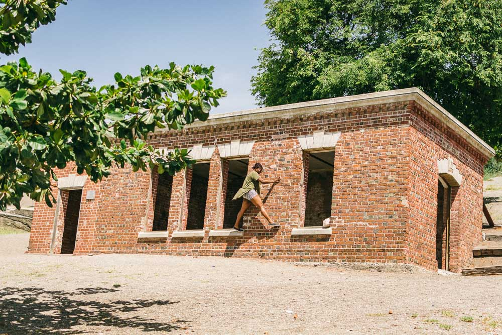 Girl Playing on the Fort Charles Giddy House