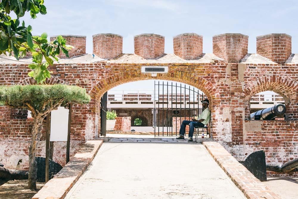 Man Sitting at Entrance of Fort Charles
