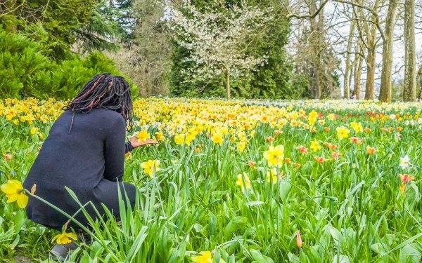 Girl looking at flowers at Mainau Island