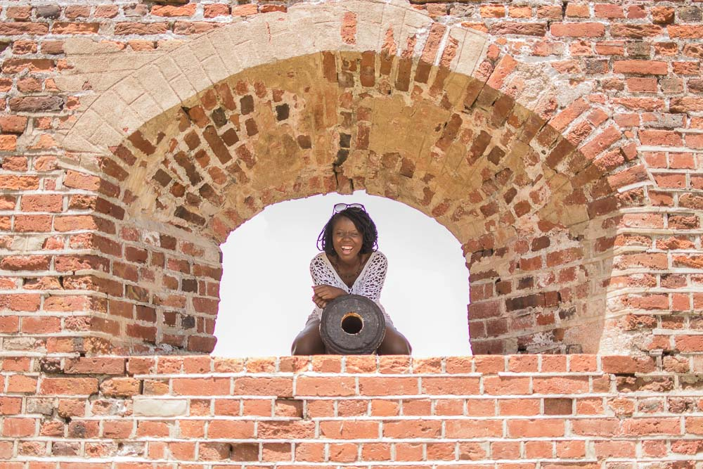 Girl Sitting on Canon at Fort Charles