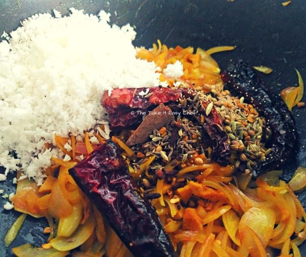 Add grated coconut and all the spices