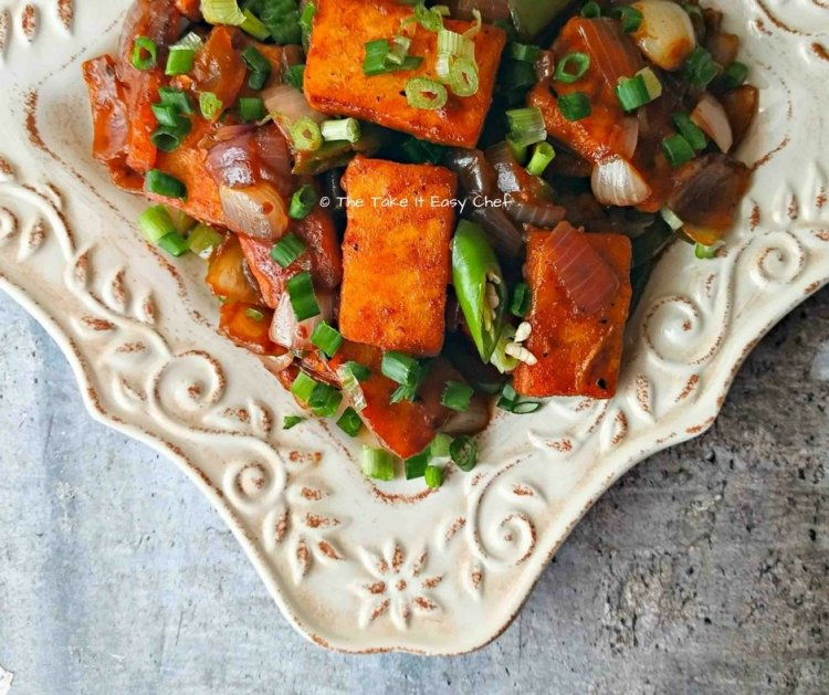 Chilli Paneer - Spicy Fried Indian Cottage Cheese with Onions and Bell Peppers
