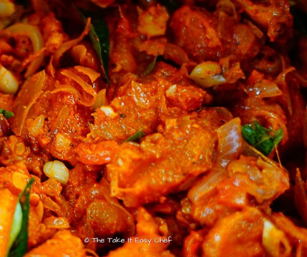 Add chicken pieces to the masala mix