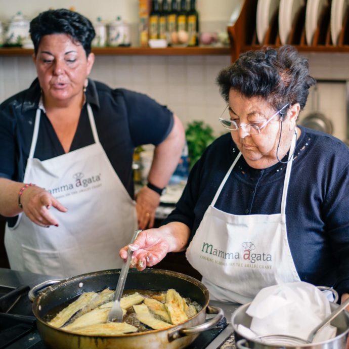 Mamma Agata making eggplant parmesan in her kitchen in ravello, italy, the taste sf