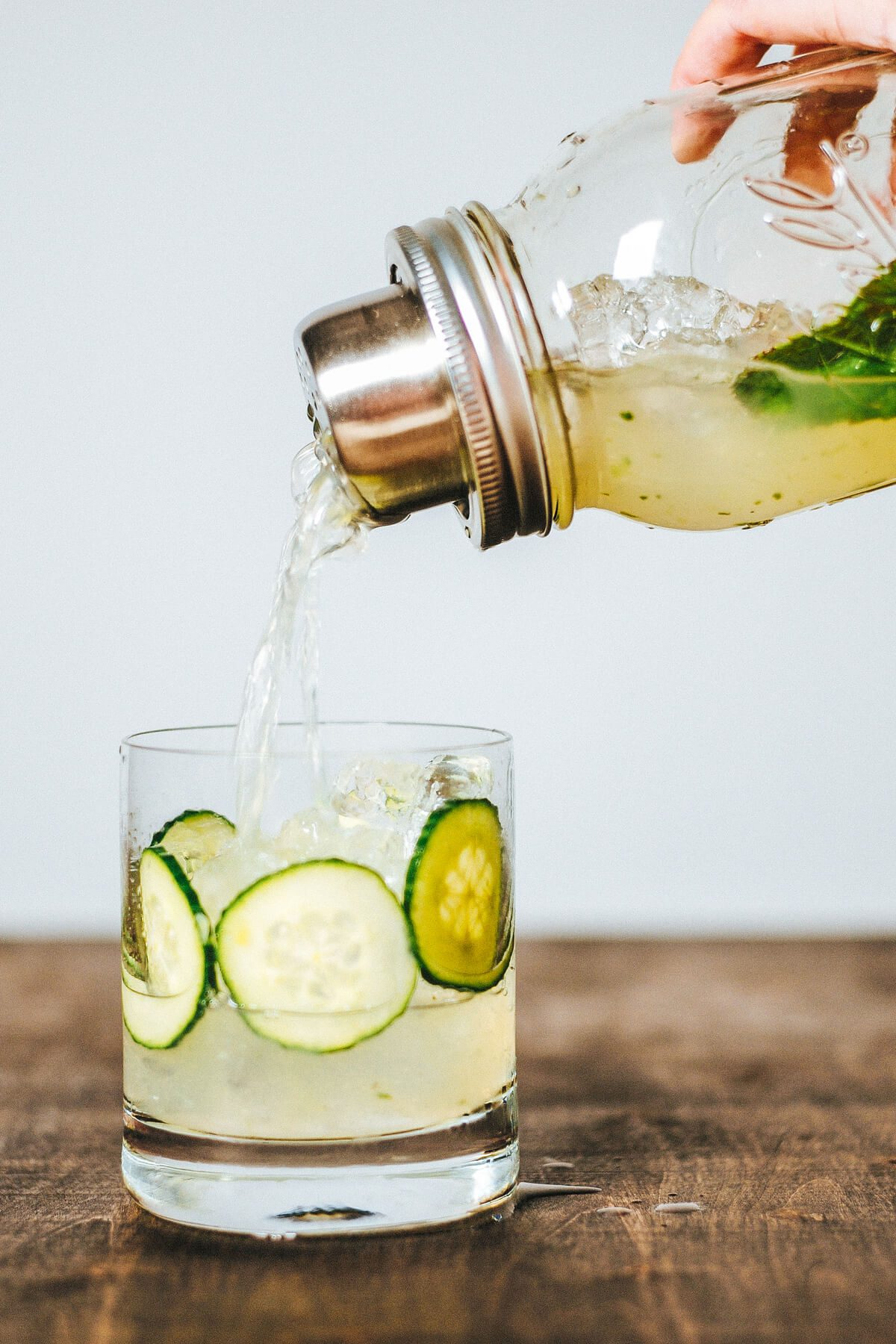 line the glass with cucumbers and fill with ice for a beautiful cocktail presentation of the cucumber ricky