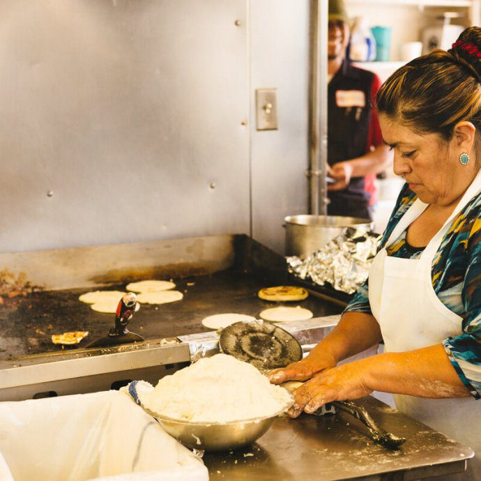 Hand made tortillas being made on la super rica taqueria in santa barbara