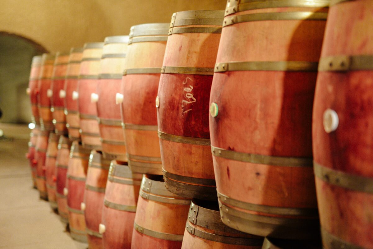 French oak wine barrels in Quintessa winery's beautiful caves