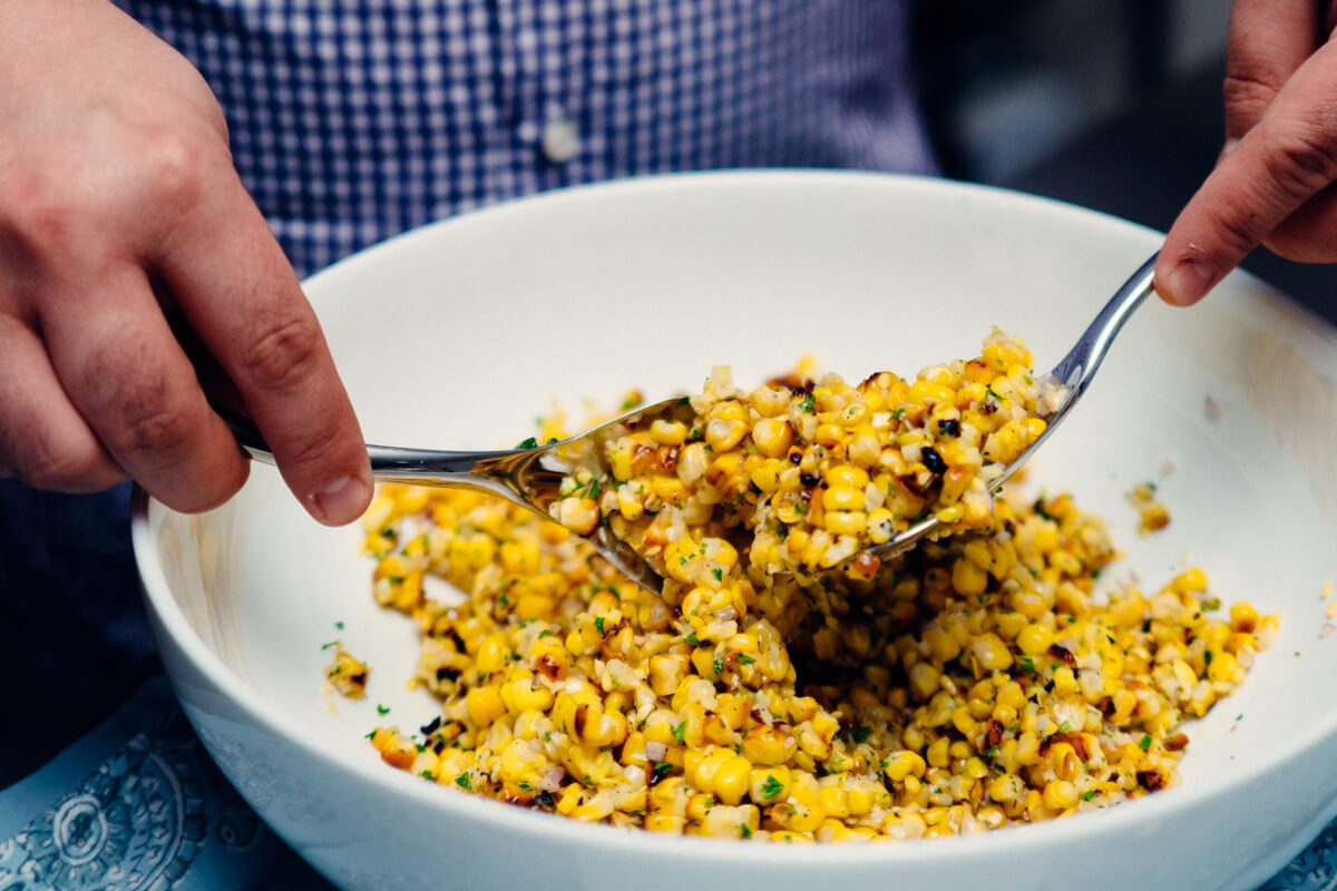 A grilled corn salad is a simple side dish to bring to any summer party or picnic.