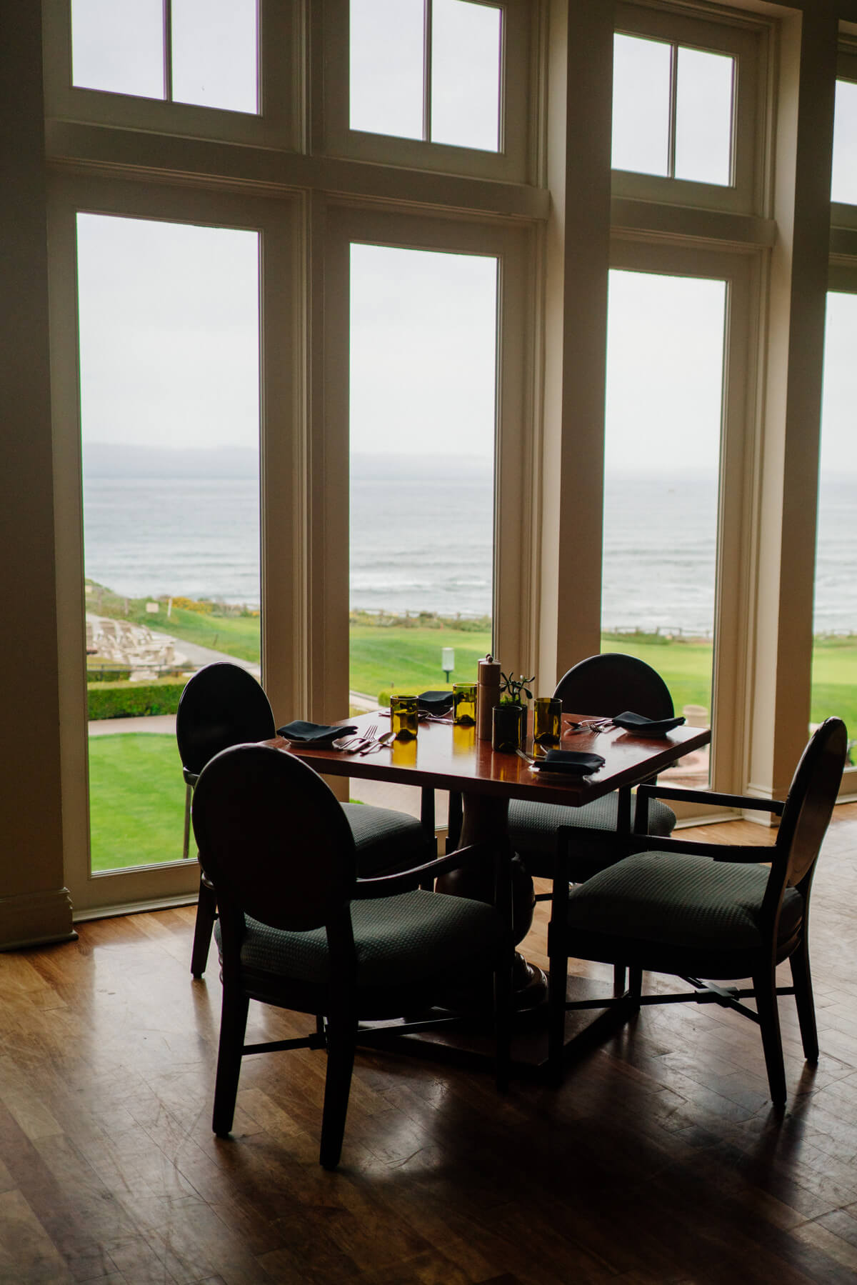 Large windows look over the ocean at The Ritz-Carlton Half Moon Bay