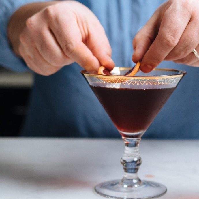 Garnish a boulevardier cocktail with a slice of blood orange, made by The Taste SF