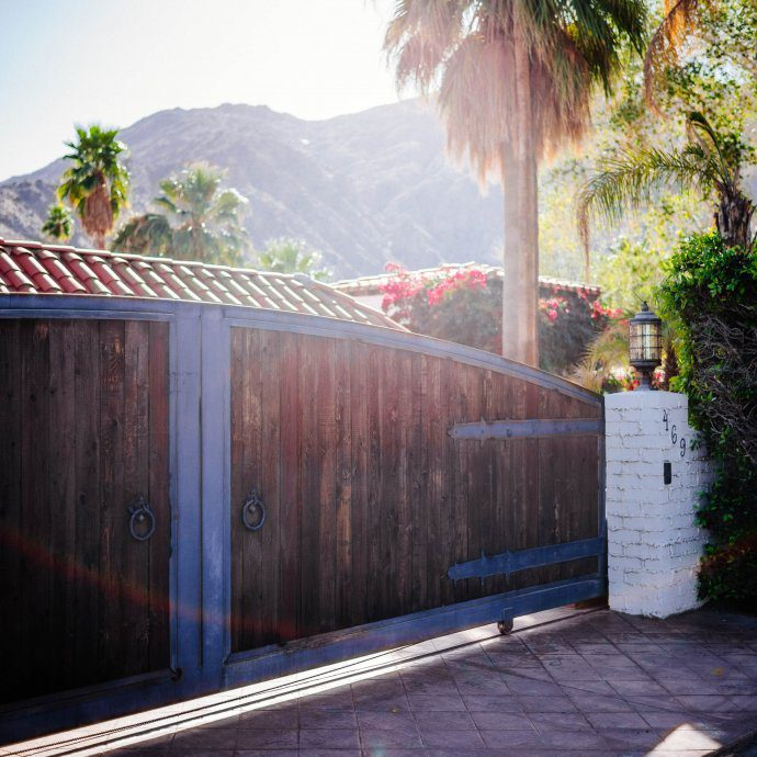 The wooden gate holds back a beautiful home in Palm Springs : Tour the beautiful Mid Century Homes in Palm Springs, The Taste SF