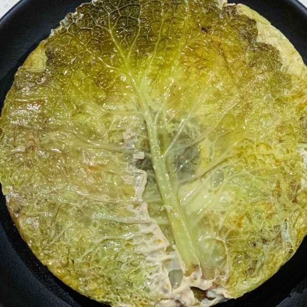 A Chou Farci is a simple French Stuffed Cabbage Recipe filled with layers of beef or pork, carrots, mirepoix, and rice or lentils. You can even make a vegetarian version. | thetastesf.com #recipe #cabbage #French