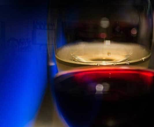 a close up of a glass of wine