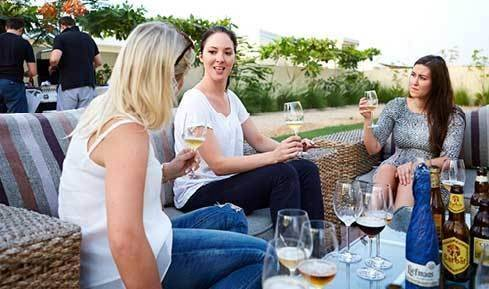 Women enjoying wine