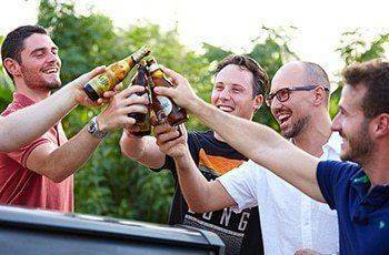 men toasting with beer