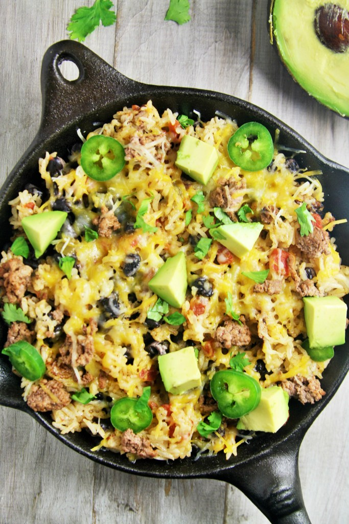 This easy, delicious rice skillet filled with burrito ingredients is sure to be a hit at your next fiesta or weeknight dinner.