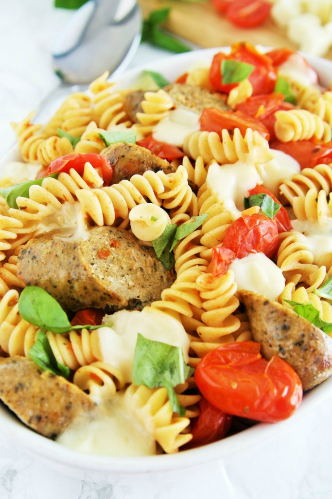 Fresh tomatoes, basil, and mozzarella cheese come together with chicken sausage in a pasta dish that is ready in under 30 minutes -- perfect for busy weeknights!