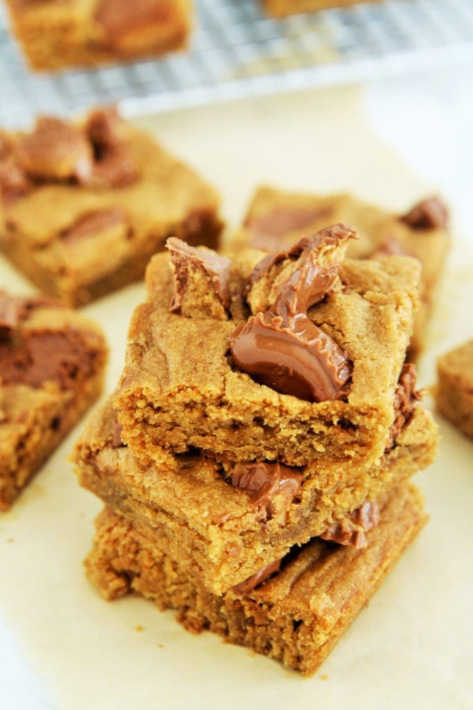 These soft and chewy blondies are bursting with the flavor of chocolate peanut butter cup, perfect treat for pairing with coffee.