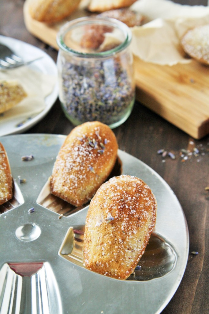 These almond madeleines are infused with the delicate flavors of lavender, honey, and lemon - enjoy with a cup of tea for relaxation.