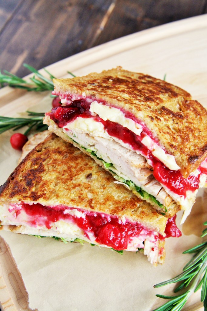 This Turkey and Brie Monte Cristo Sandwich is made with flavorful turkey breast, brie, cranberry sauce, and arugula - use up all those Thanksgiving leftovers or enjoy this all year round!