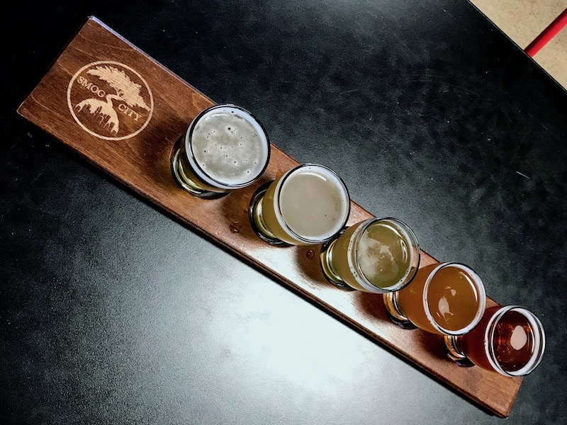 beer flight at smog city