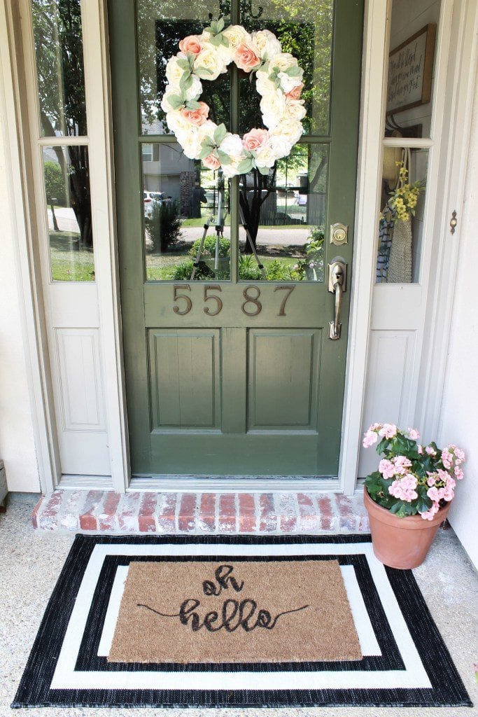 We have a Pottery Barn slipcover sofa review, spring decor, vintage artwork, botanical printables, a DIY roman shade, and a DIY doormat.