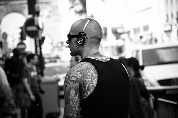 streetstyle with an inked boy, full of tattoos, during the Paris Fashion Week , photo by The Tattoorialist