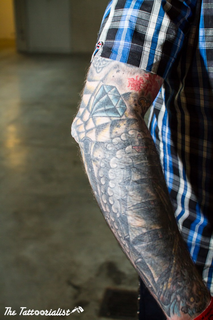 man with tattoo photo by Nicolas Brulez aka The Tattoorialist