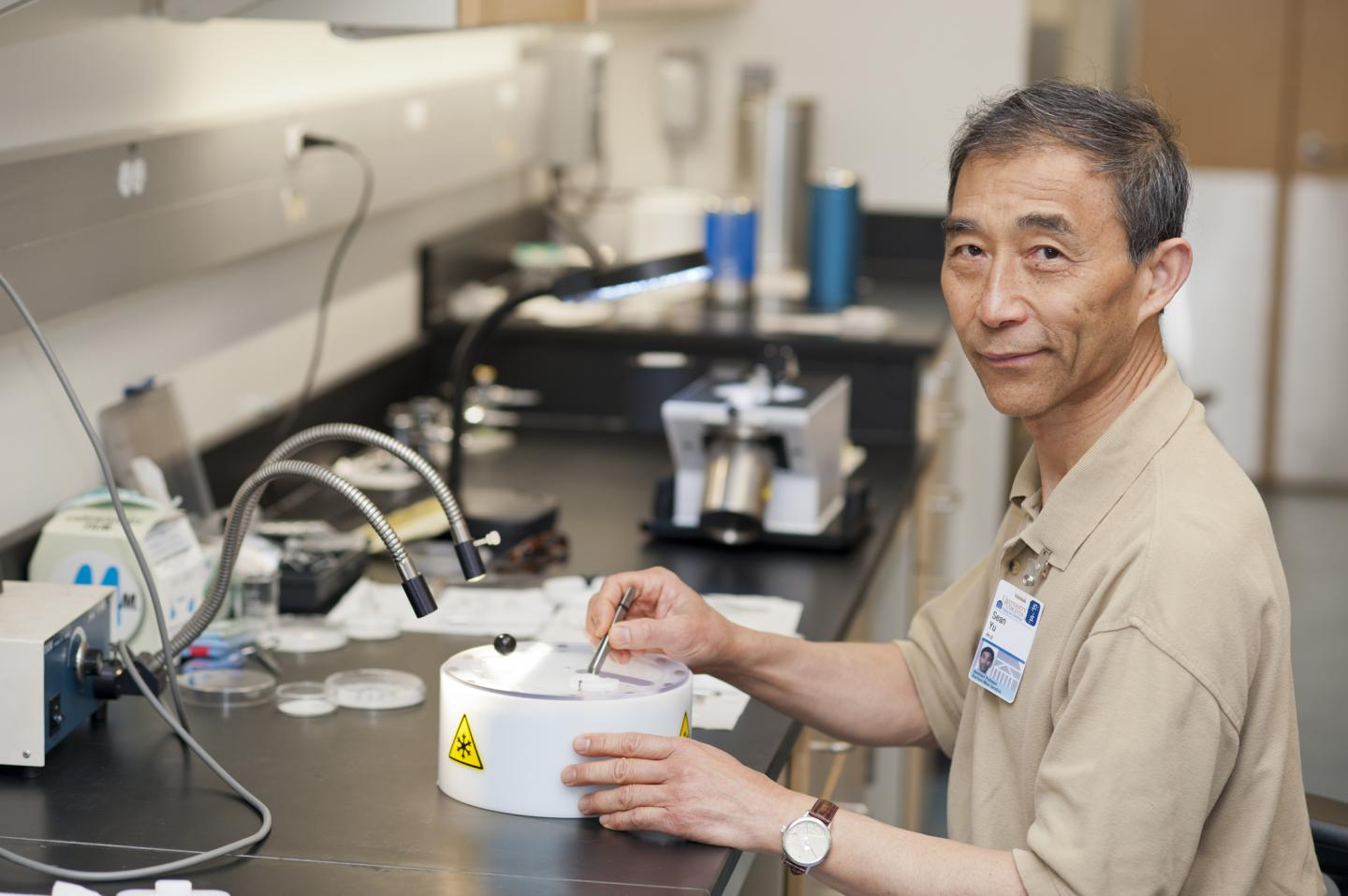 Xiong (Sean) Yu, Ph.D., demonstrates a step in the process of prepping a sample for analysis. image: Kay Taylor | University of Virginia Health System