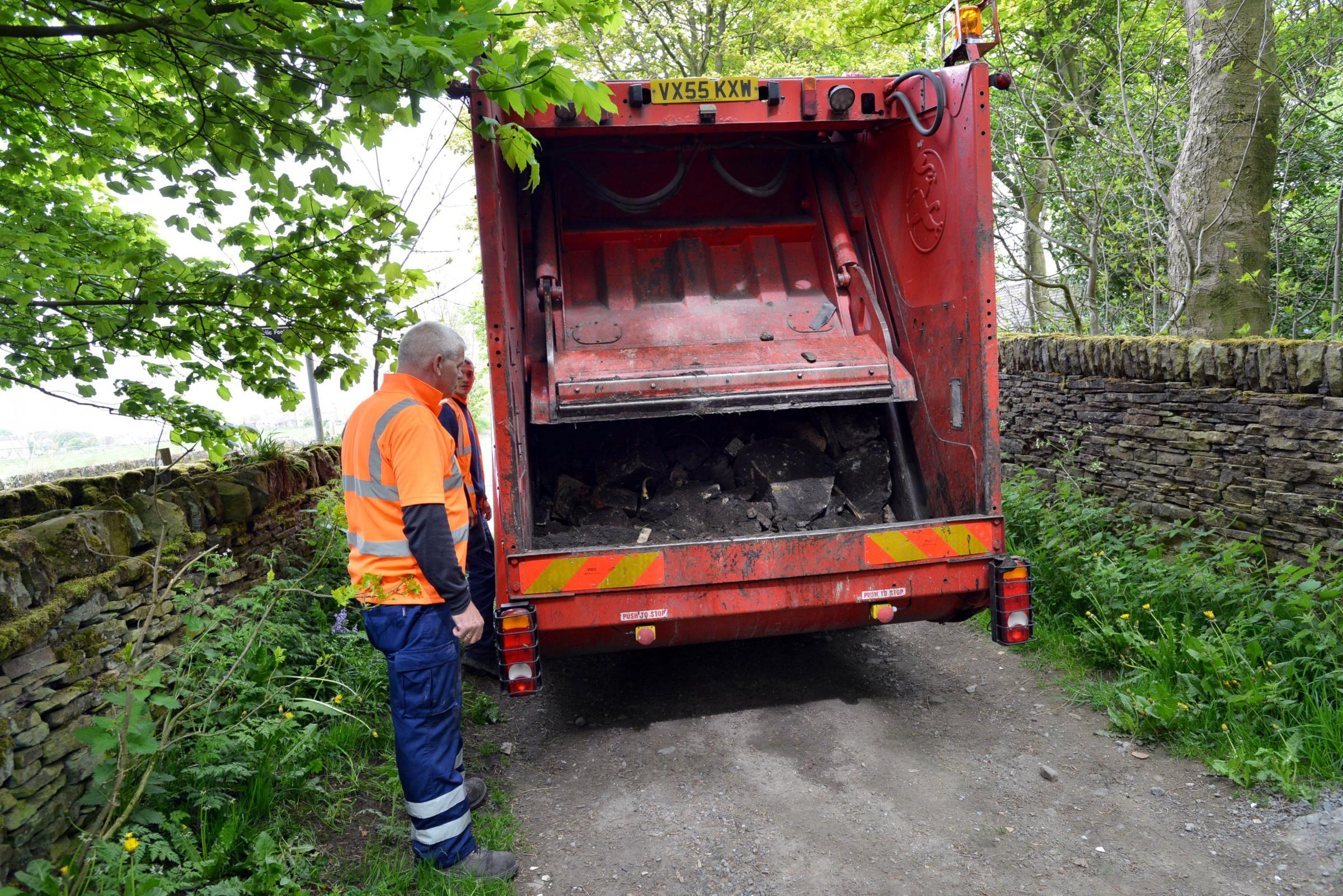 bradford council sofa removal blair 4 piece leather set loveseat chair and ottoman bricks concrete soil dumped in stocks lane telegraph outrage as flytipping blocks road clayton heights workers remove
