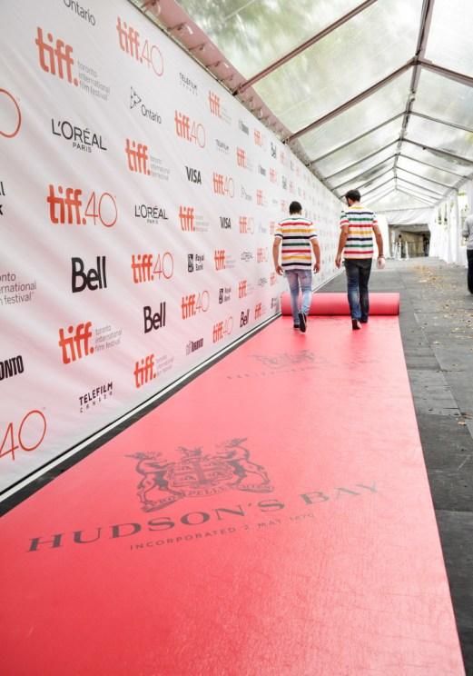 Official Festival sponsor Hudson's Bay rolls out its striped red carpet at Roy Thomson Hall on September 9, 2015 to celebrate the start of the 40th Toronto International Film Festival. Photo credit: George Pimentel