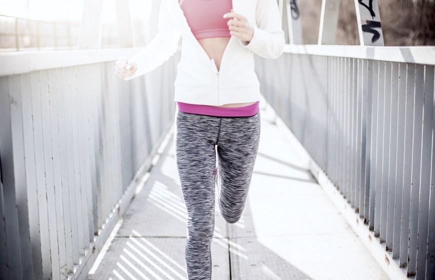 Girl running on bridge