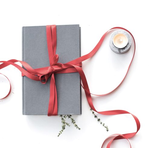 Book with ribbon and candle