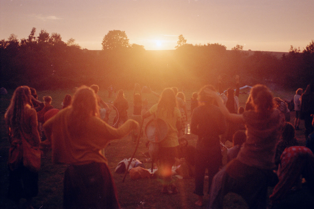 The first sunset after days of rain and no sun coming through, a very magical sundance moment with didgeridoo, drums, flute and the epic sound of a gong, Hungary.