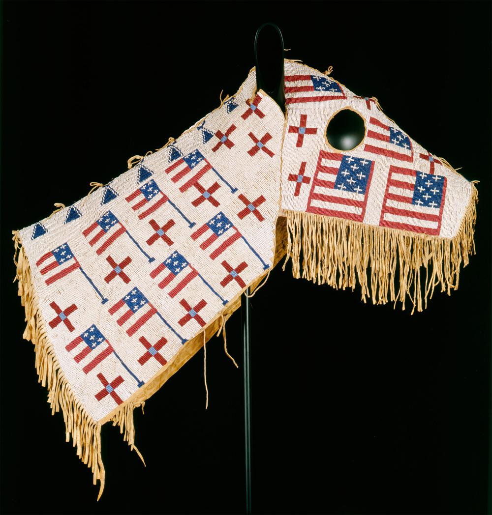Horse Mask, Blackfeet, 19th century. Tanned buffalo hide, cotton cloth, ribbon, wood, brass tacks, glass beads, ochre (45.7 cm x 26.7 cm) Buffalo Bill Center of the West, Cody, Wyoming, U.S.A.