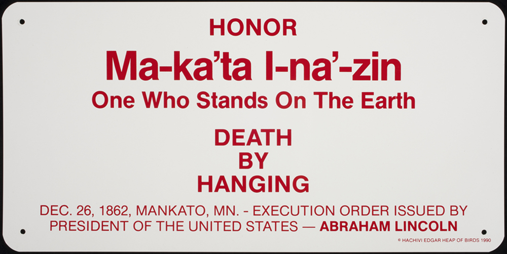 Ma-ka'tal-na'-zin (One Who Stands on the Earth), 38 signs from Building Minnesota (site specific public work), 1990 by Edgar Heap of Birds, Hock E Aye Vi. Enamel on aluminum 18 x 36.25 x .0625 in. Collection Walker Art Center, Minneapolis. Acquired in conjunction with the exhibition Claim Your Color: Hachivi Edgar Heap of Birds (1990), 1993.