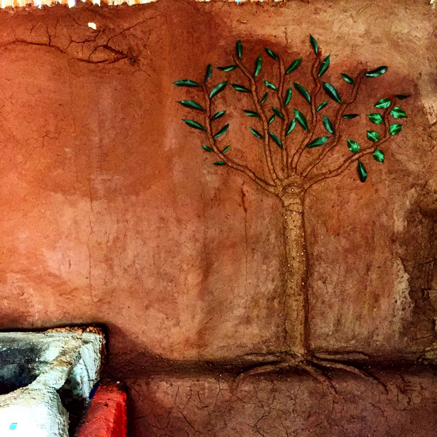 Artwork on the cob walls inside the kitchen.