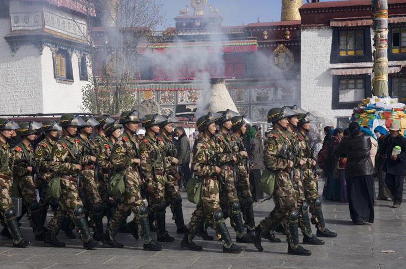 ... Tibet's capital Lhasa, amid Tibetan pilgrims performing their rituals