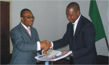 General Manager, Rivers State Newspaper Corporation (left) presenting some copies of The Tide Newspapers to the Executive Director of Rivers State  Sustainable Development Agency, Mr Noble Pepple, during his visit to the corporation, yesterday.