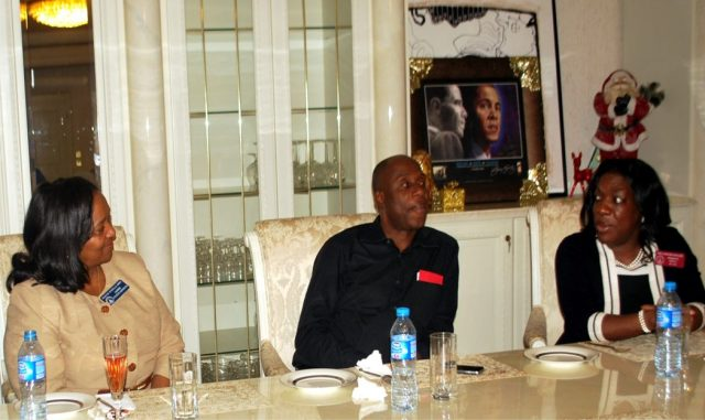 Rivers State Governor, Chibuike Amaechi (middle) receiving the leadership of the Congressional Black Caucus of the State of Georgia, led by Hon. Dee Hawkins-Haigler (right), at Government House, Port Harcourt while another member of the team watches.