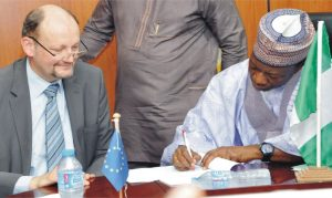 Minister of National Planning, Dr Abubakar Sulaiman (right), signing financial agreement for the 11th European Development Fund Support to strengthen community-based psychosocial and protection services for children and adolescents in Borno, in Abuja, recently. With him is the head, European delegation, Mr  Michel Arrion.