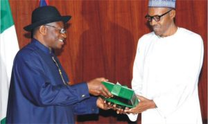Outgoing President, Goodluck Jonathan submitting his handover notes to President-elect, Muhammdu Buhari at the Presidential Villa, Abuja yesterday