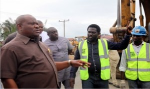 Governor Nyesom Wike of Rivers State, with Project Manager, Monier Construction Company, Mr. Collins Wonodi (2nd left), during the inspection of the Rumuolumeni Road project by the governor in Port Harcourt recently.
