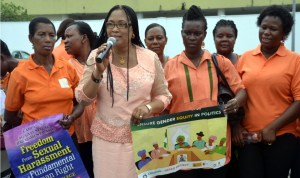 Permanent Secretary, Ministry of Women Affairs, Mrs Atosemi Teetito (2nd left),addressing NAWOJ membes during a peace walk to commemorate International Women's Day in Port Harcourt.Photo: Ibioye Diama